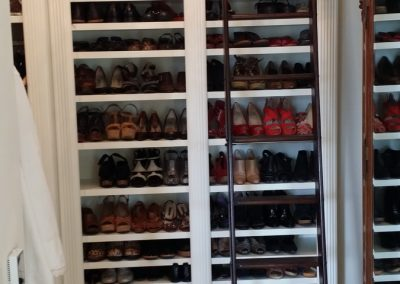 closet with custom sized shelving for all kinds of shoes