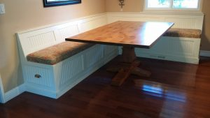 Table on p pedestal table with Custom banquette Seating
