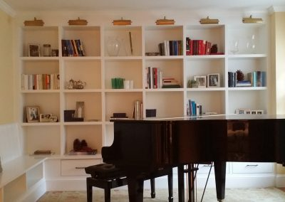 Contemporary built-in Painted 2 inch book case with picture lights at top